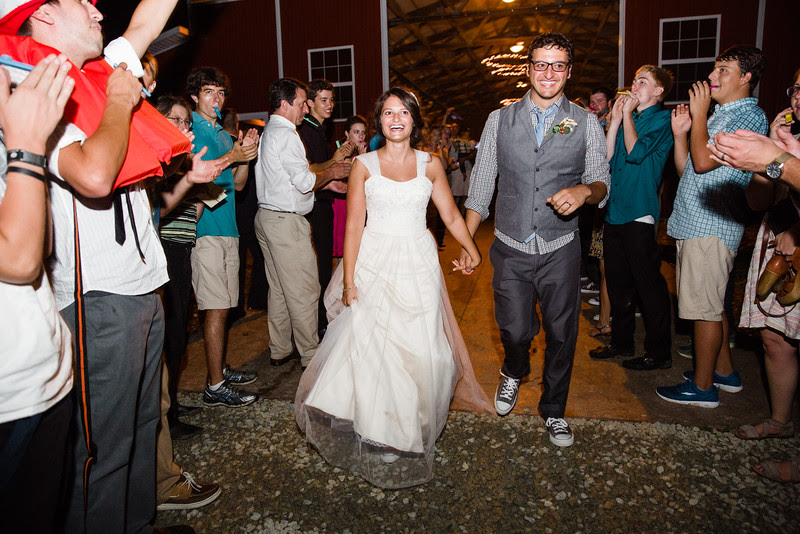 A Kazu / kazoo release at the end of the night for the bride and groom  at Busy Barns Adventure farms before a wedding at Busy Barns Adventure Farms in Fort Atkinson Wisconsin about 30 minutes east of Madison and an hour north of Chicago. Photo by Mindy Joy Photography.