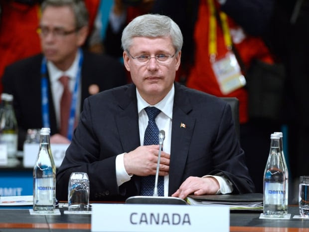 Stephen Harper had a showdown with Russian President Vladimir Putin on Saturday, telling the Russian leader to 'get out of Ukraine.'