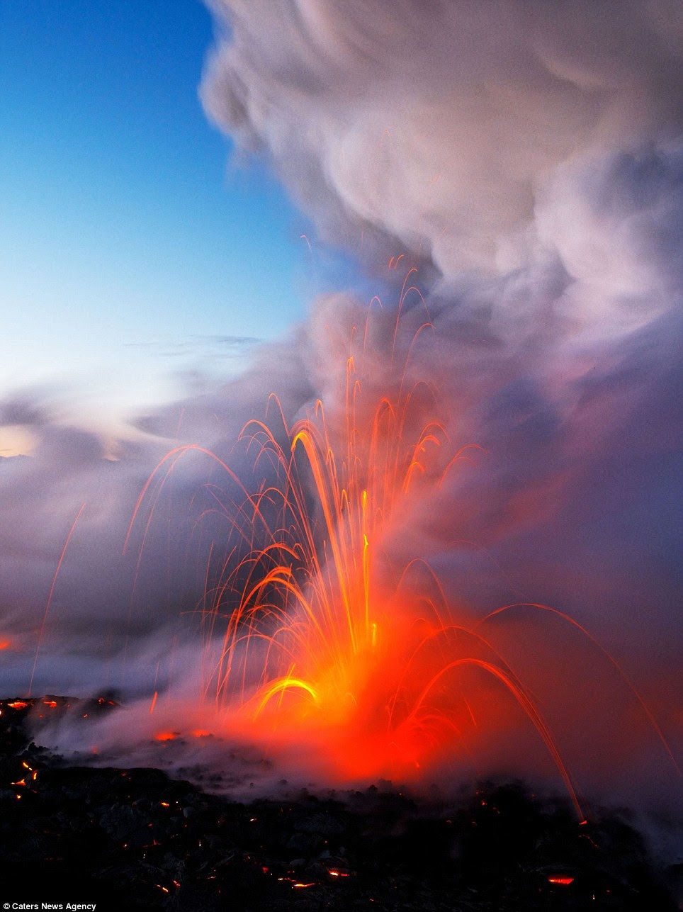Spark of attraction: Flames shoot up through water as a volcano errupts