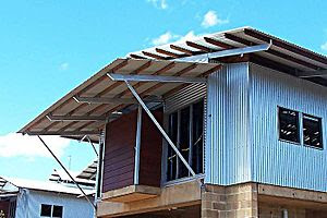 hardwood purlins fixed to steel supports on a ...