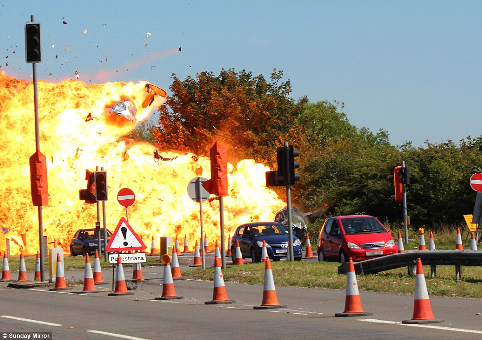 Changes This is moment the Hawker crashed into cars in a ball of flames -  the disaster could now lead to an overhaul of safety rules for British air shows
