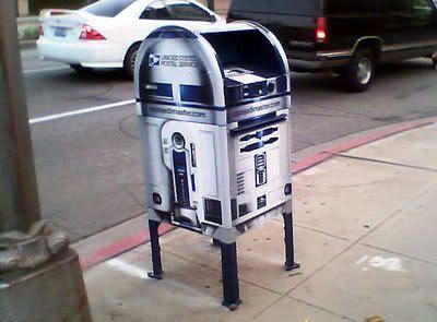 A mailbox shaped like Artoo Detoo.