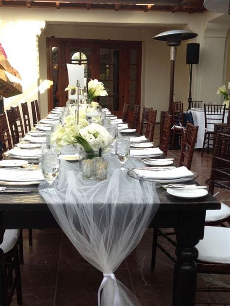 Tulle table runner tied with ribbon is an inexpensive way
