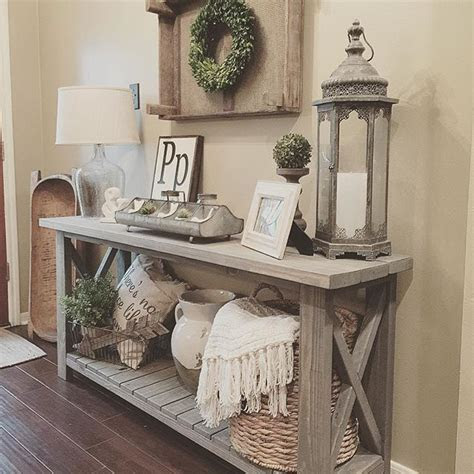 Farmhouse console table vignette in a foyer   Farmhouse