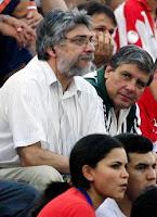 Lugo, left, watching football