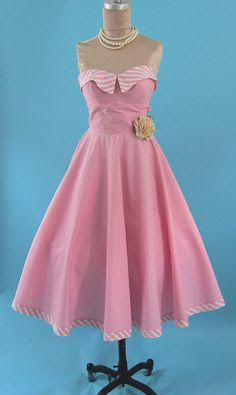 My aunt had one similar to this only in tangerine with a matching Bolero jacket. I wore it in 1979 to my Jr high 50's day dance.