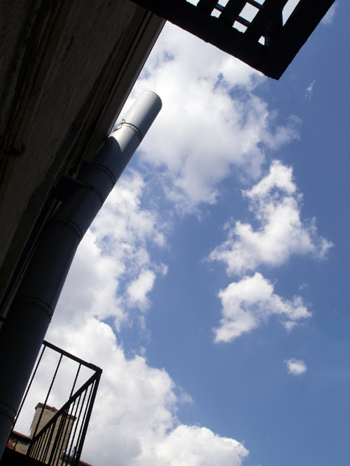 clouds and sky with pipe and railing