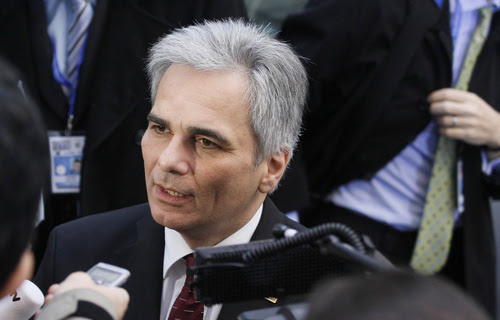 Austria's Chancellor Faymann arrives at the European Union summit in Brussels