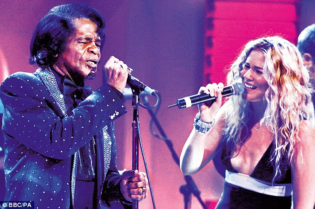 Joss performs with James Brown. Many stars profess to be normal but she appears to have her feet genuinely on the ground