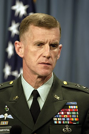 Major General Stanley A. McChrystal listens to...