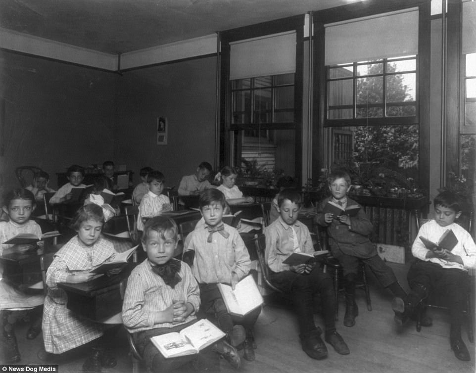 Children read textbooks in an open air school for cripples in the US circa 1900s