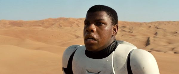 A Stormtrooper played by John Boyega realizes that he may have really bad sunburn after waking up on the sands of Tatooine(?) in STAR WARS: THE FORCE AWAKENS.