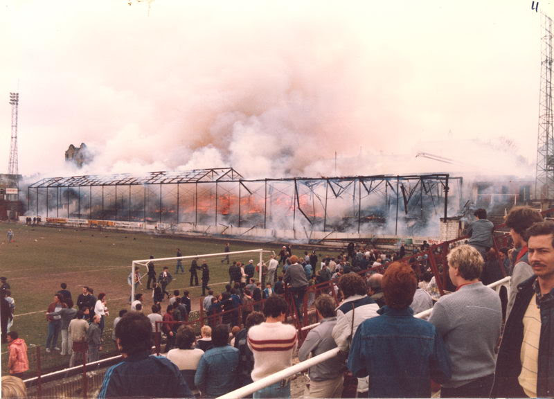 Main stand engulfed in flames in the Bradford City stadium ...