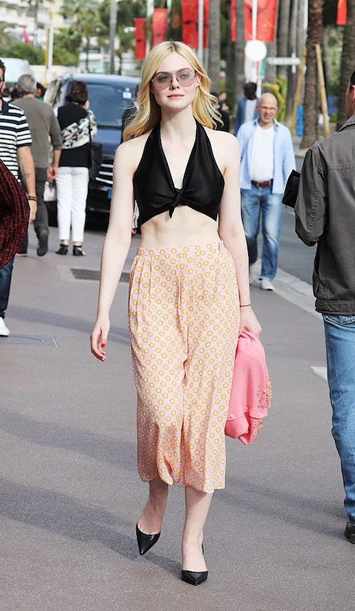 Le Fashion Blog Elle Fanning Black Cropped Top Printed Cropped Trousers Black Heels Via Who What Wear
