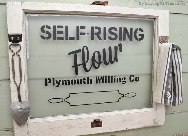 stenciled window advertising sign