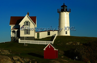 the nubble lighthouse with a bright blue sky