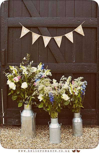 Vintage milk churns used as rustic vintage wedding decorations - www.helloromance.co.uk