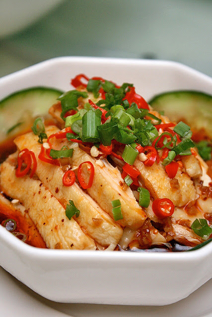 Boiled sliced chicken and cucumber with homemade chili oil