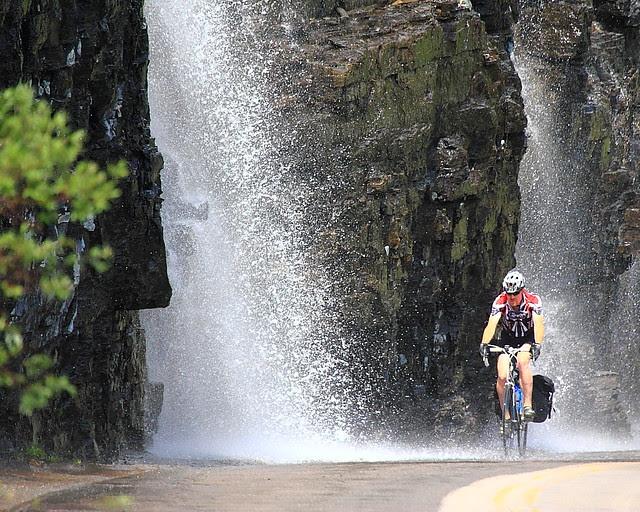 IMG_4005 Biker Passing Weeping Wall, Glacier National Park