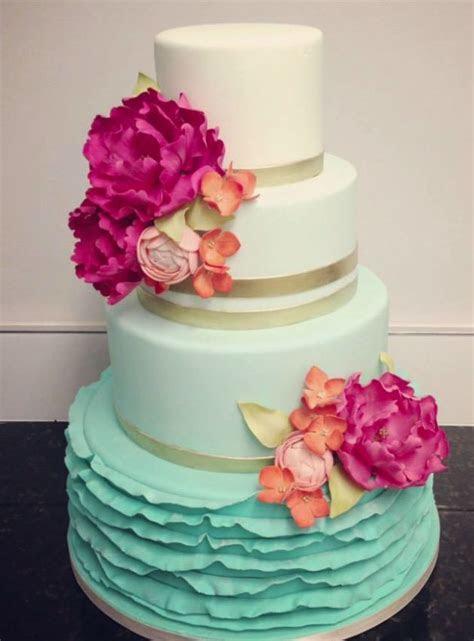 Aqua ombre ruffles wedding cake with sugar plum flowers