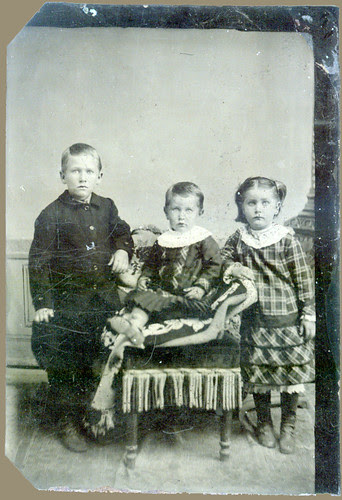 Tintype: A boy, a girl and then another girl.