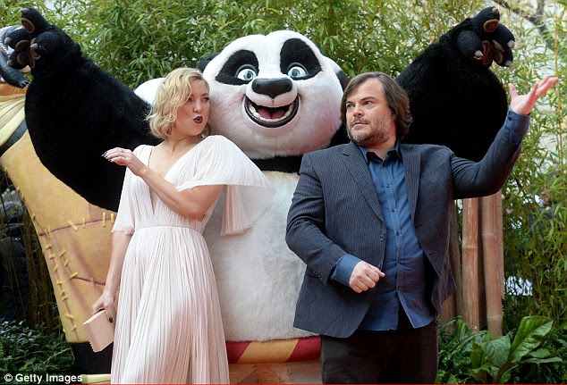 Playing up to the panda: Clearly delighted with the turn-out, both stars flashed winning smiles as they made their way down the red carpet, even stopping to pose with actors in costume as characters from the film.