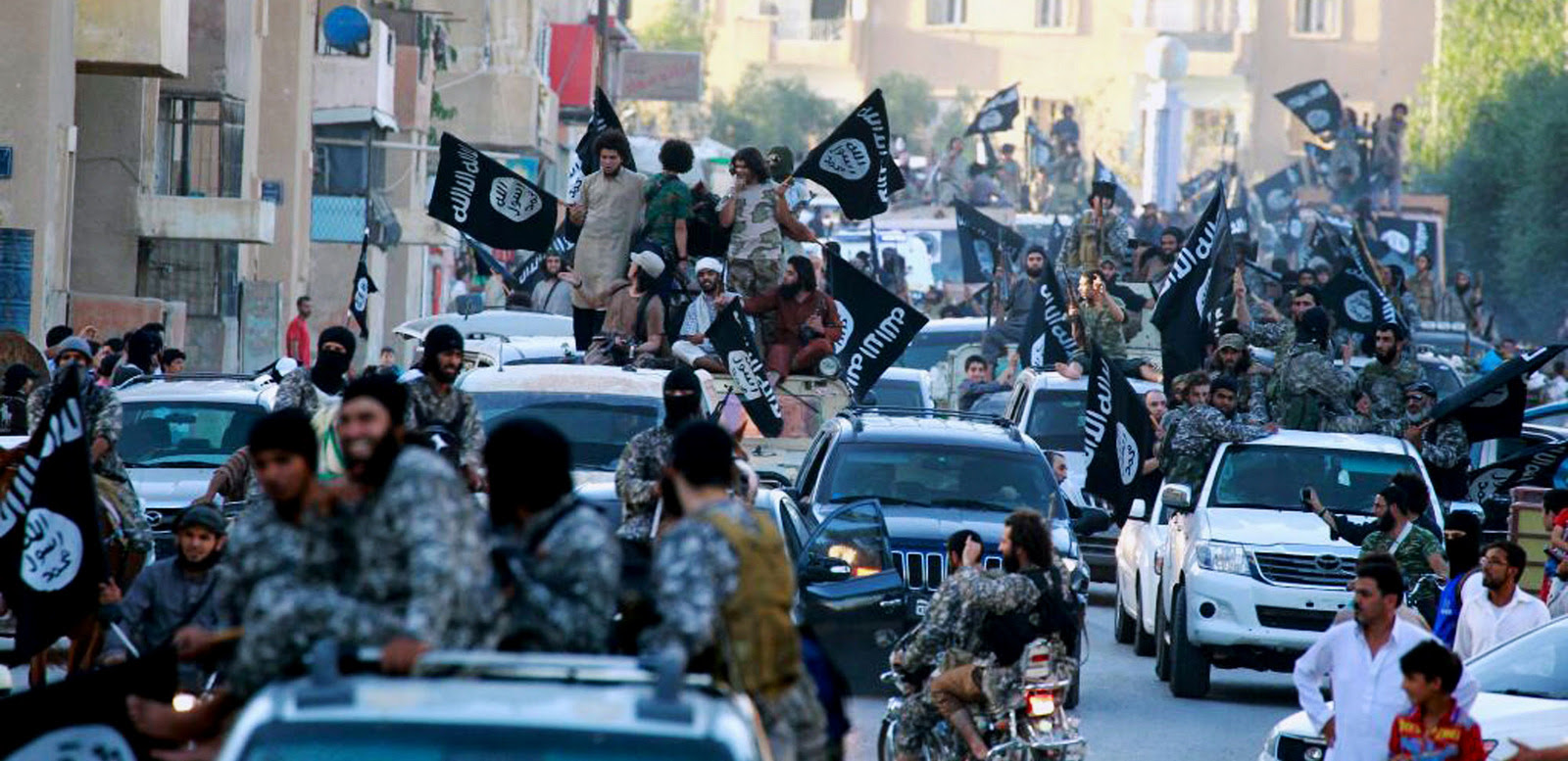 ISIS fighters from hold a celebratory parade after capturing Raqqa, Syria.