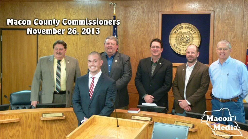 Derek Roland poses with the Macon County Commissioners