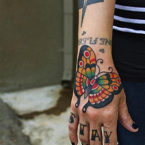 butterfly hand tattoo tattoo ideas gallery