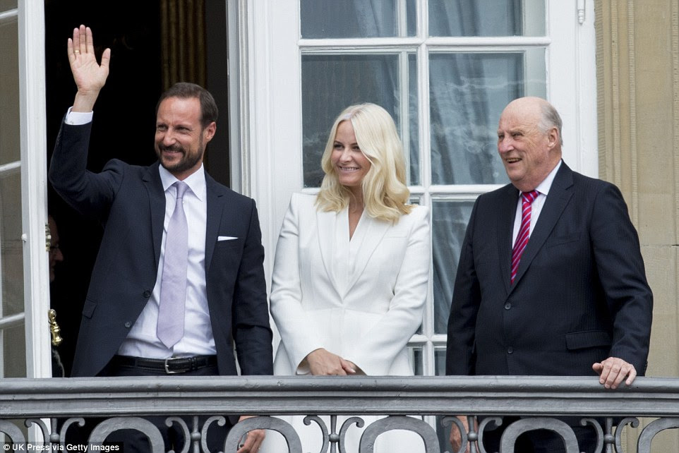 All smiles: On a second balcony were Norway's King Harald (right), Crown Prince Haakon and Crown Princess Mette-Marit