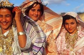 Libyan girls in their traditional Urrday costumes and gold jewelry.