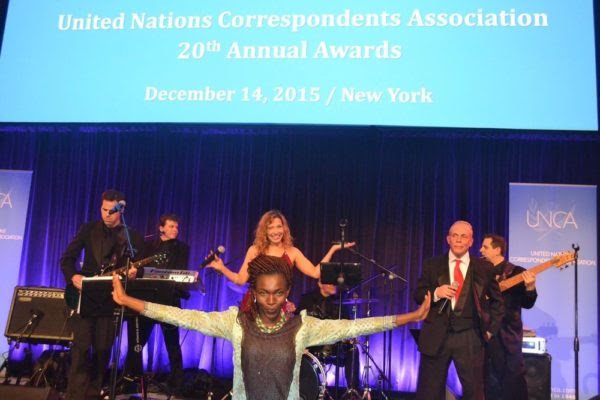 Excited Tina Armstrong with band at the UNCA Awards in New York