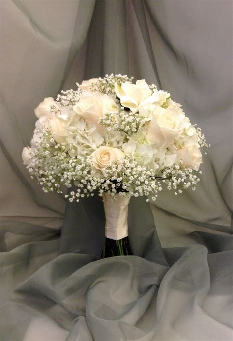 White bridal bouquet with hydrangea, roses, babies breath