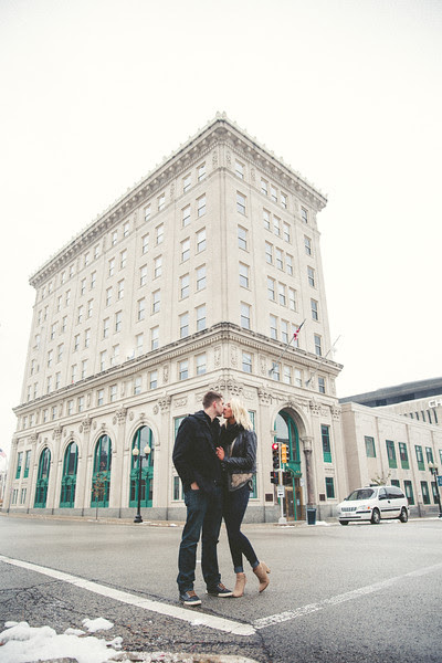 A winter photo session with Natalie and Matt with falling snow in Rockford IL. I photographed their wedding one year ago and we met up for couple's photos in a park and around downtown Rockford for some urban locations.