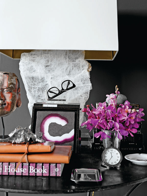 home designed by Cathy Echols, black wall, black and purple, accessories