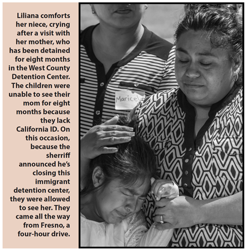 Liliana comforts her niece, crying after a visit with her mother, who has been detained for eight months in the West County Detention Center. The children were unable to see their mom for eight months because they lack California ID. On this occasion, because the sherriff announced he's closing this immigrant detention center, they were allowed to see her. They came all the way from Fresno, a four-hour drive.