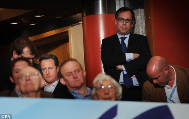 Prime Minister David Cameron and his chief of staff Ed Llewellyn (standing), who was made aware of a sexual harassment complaint filed against Mr Rock