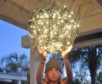 Repurpose Flower Baskets into a Glowing Outdoor Chandelier | Club ...