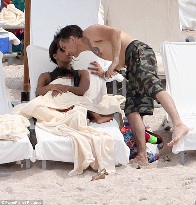 What he wants: A source tells People that Olivier 'never wanted the divorce and still doesn't'; the couple was caught in another loving moment on the beach