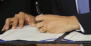 President Obama signs HCR