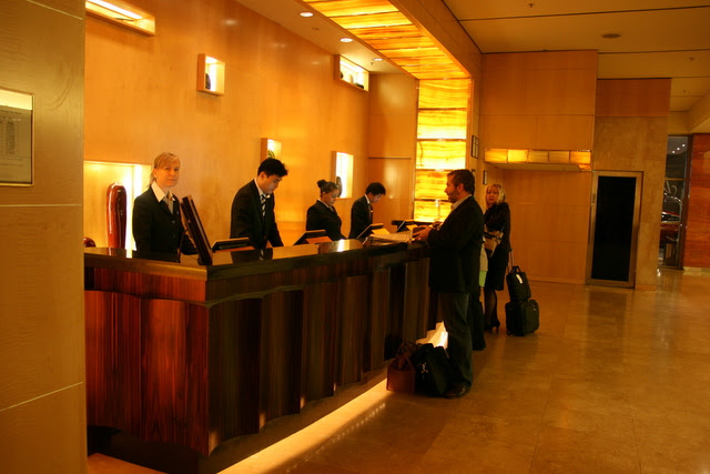 The concierge and cashier at Amora Jamison Sydney