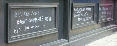 Comments chalked on the wall outside Made in Belfast restaurant/restolounge in Wellington Street, Belfast