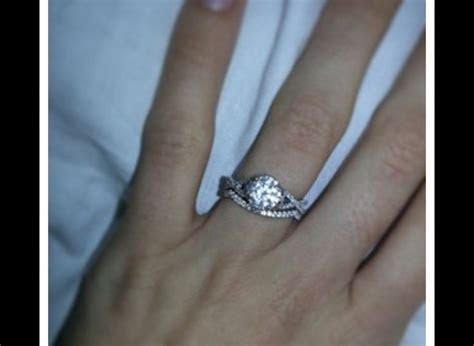 Wedding band. Engagement ring with halo and infinity band