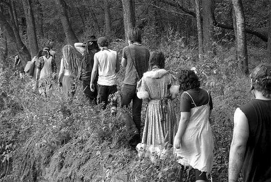 Travelers meeting in the woods.