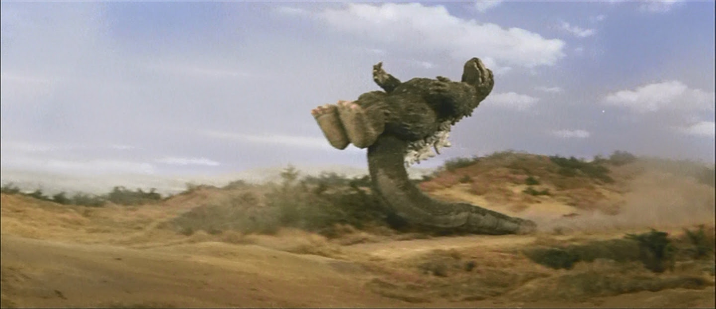 The infamous Godzilla tail-supported drop kick.