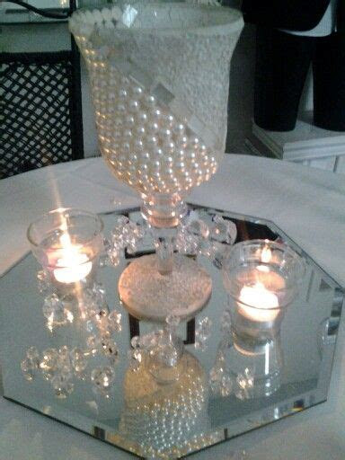 pearls and diamonds centerpiece.   Bouquets from Bennett