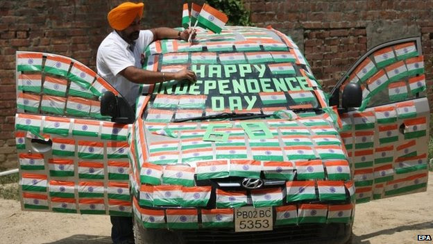 "Indian artist Harwinder Singh Gill decorates his car with Indian flags on the eve of India""s Independence Day in Amritsar, India, 14 August 2014."