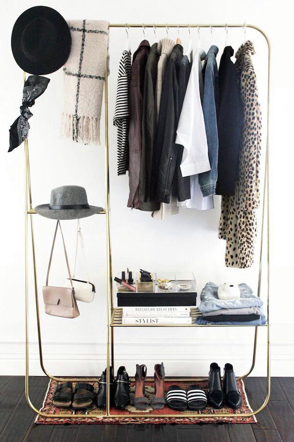 Le Fashion Blog Stylish Open Closet Gold Clothing Rack Hats Scarves Vintage Turkish Rug Jackets Leopard Coat Fashion Books Home Decor Interior Design Jenn Camp