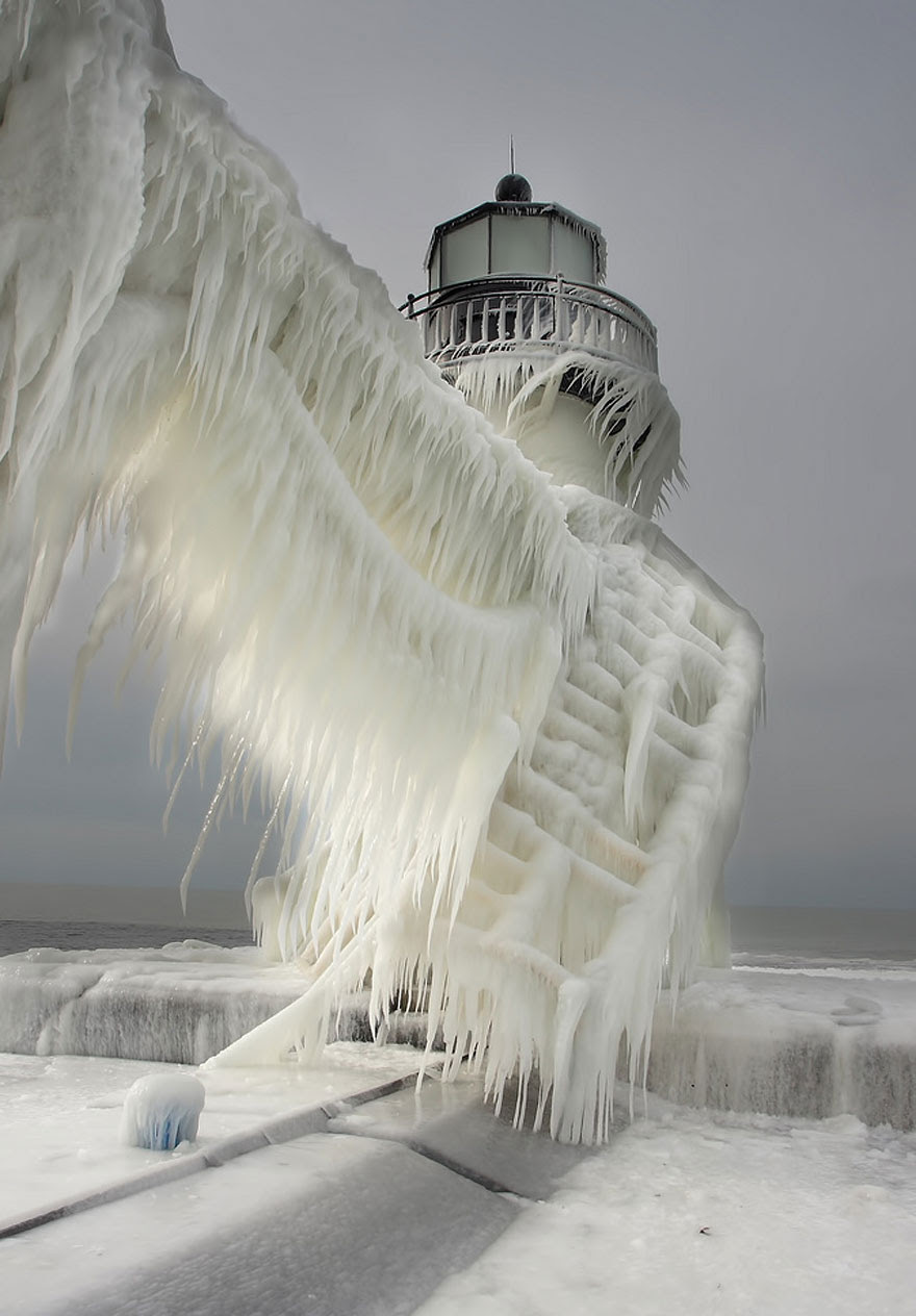 http://www.boredpanda.com/flozen-lighthouses-on-lake-michigan-shore/