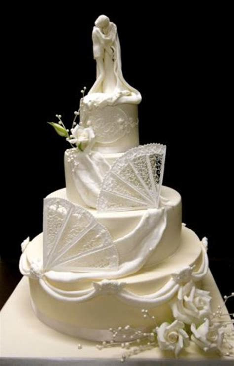Ivory And White Wedding Cake With Royal Icing Fans And